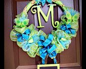 Baby wreath with customized initial and detachable information slate