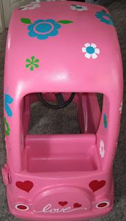 Little Tikes Cozy Coupe makeover using spray paint and vinyl decals.
