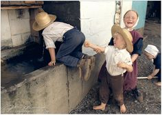 Amish children having fun plaing games on the farm