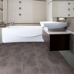 Vinyl tile. Definitely not as green, but if we need to cut costs, we could use this instead of tile in the mudroom, laundry room and D's bath. TrafficMaster Ceramica 12 in. x 24 in. Coastal Grey Vinyl Tile Flooring (30-Case) Model # 24716 Internet # 202191244 $1.69 /Sq. Ft.