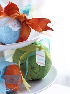 Fortune surprise balls, wrap paper slips around styrofoam ball in layers and layers of crepe paper streamers.