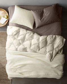 Warm. Breathable. Luxurious. Premium white goose down wrapped in soft organic cotton. Now with 600 fill power, slightly lighter than our previous comforter for year-round comfort and elegant drape.