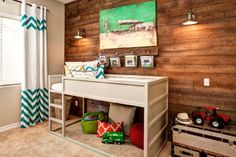 Boys room with IKEA Kura loft bed painted white. Love that wood paneled accent wall. #DIY