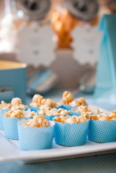 """Caramel popcorn as another sweet treat option! And another way to bring in the color scheme w/ the """"cupcake"""" wrappers they go in."""