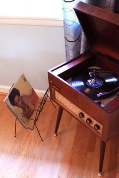 Record player with record holder