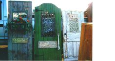 Old doors salvaged and decorated with iron work for the garden.  Repurposed by poster 2008