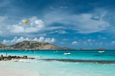 """The water was a gorgeous color...so bright it appeared to glow."" Orient Bay Beach - Orient Bay, St. Maarten/St. Martin"