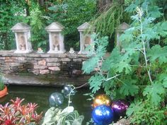 Garden designer Ryan Gainey's witty garden in Atlanta I had floating balls in my pond but birds kept landing on them and slipping and drowning so I removed them. I hope you have better luck with your balls. (:-)) Savannah and Atlanta 044