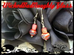 "Just in time for fall! Coraline earrings from the studio of WickedBadNaughty Glass! These beautiful, OOAK, lampwork glass & shell earrings with look GORGEOUS with your favorite sweater! The lampwork beads were made by me in my studio & have been kiln annealed for strength & durability. They have been WIRE WRAPPED, paired with coral colored shell, hang from silver fish hook wires & are 1 3/4"" from end to fish hook. $12.00    For other glass addictions go to http://WickedBadNaughty.Etsy.com"
