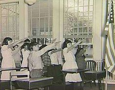 Before 1942, American children pledged allegiance to the flag with the Bellamy salute. Worried that it might be confused with the Nazi's Roman salute, Congress changed the salute to simply placing a hand over the heart.