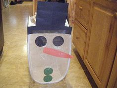 Toss the snowball in the snowman - use laundry hamper