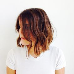 For those looking for a bolder chop that isn't, you know, too bold, Trueba's angled bob is definitely a favorite. The stylist used a one-and-a-quarter-inch flat iron to create a bedhead-inspired wave. Just make sure to keep the ends curl-free.