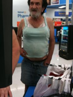 Guy with a bra and halter top