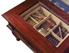 Top view of coffee table humidor. This humidor holds 400 cigars and sits in your living room! Click the picture to read the review. http://www.theperfectgiftsforhim.com/the-coffee-table-cigar-humidor-review/