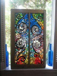 Mosaic on recycled window I made in 2008. Gypsy River.