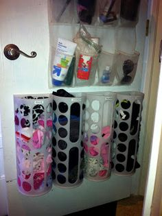 COAT CLOSET STORAGE: Every once and awhile I have a stroke of genius. Case in point: my storage solution for all the hats and gloves that were piling up in our coat closet. I screwed the Garbage bag holders from Ikea into the coat closet door. The BEST part is the little holes allow the kids to grab glove without having to dump out the entire bin to get to them. LOVE it!