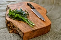 natural edge cutting board by red onion woodworks