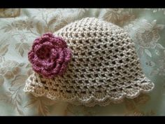 This is an easy crochet hat that a beginner crocheter can do.  The beanie or hat uses double crochet and chain stitches.  The flower instructional video can be found at:  http://youtu.be/XlWt0n0srfA  and  http://www.momof5daughters.blogspot.com/2010/06/how-to-crochet-flower.html