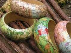 (Very clever!~C) A great idea as a souvenir of your travels! Decoupaged Wooden Bangle covered with maps