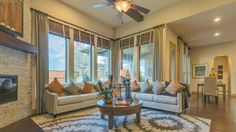 Imagine sharing stories with guests by the elegant fireplace in your Darling Homes living room, with a view of the stars through the expansive windows.