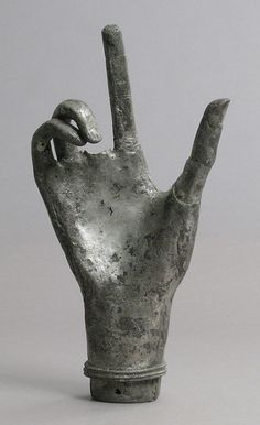 Reliquary hand, French.  13th century.  copper, silver plated
