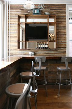 Brooklyn-based interior designer Jen Chu and her boyfriend recently built out this reclaimed wood bar to act as a gathering space for interactive media company InTheMo