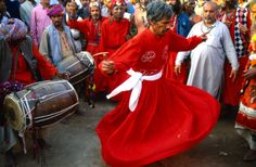 Pakistan, Sind, Sehwan e Sharif, Derviche man dancing amongst crowds