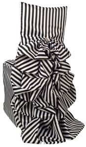 Black and white striped ruffled chair covers.