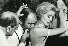 "Director Luis Bunuel poses actress Catherine Deneuve for a scene during the production of the 1967 film ""Belle de Jour""."