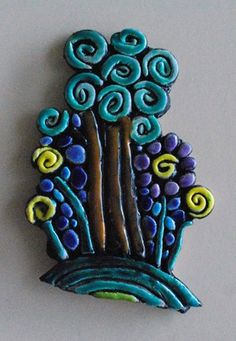"""Coil Design, looks like a good way to get kids to create """"pictoral"""" designs with clay, without just drawing in to it. Also, a nice tie in to movement of line/vanGogh."""