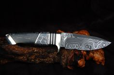 These knives are works of ART! Silver infused quartz with picasso marble.-Steve Nolte Knives