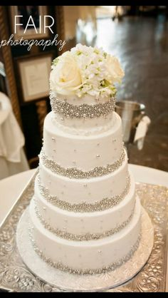 The bling details in this cake look like they'd compliment my dress. Beautiful wedding cake - especially if the guys wear gray