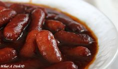 1 package Little Smokies sausage (14 oz, I think)  1/3 cup ketchup  1/3 cup brown sugar  3/4 teaspoon Worcestershire sauce  1/3 cup barbecue sauce       1.  Use a 2 or 3-quart slow cooker. Dump everything in. Stir well and cook on low for 4 hours, or high for about 2. Make sure the smokies are hot throughout and serve out of the slow cooker with toothpicks