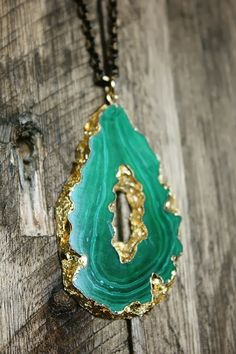 Believe it or not, you can gold leaf a geode yourself. Give it a try! It makes a beautiful necklace pendant.