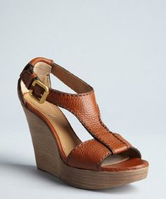 Chloe tan leather 'Prince' t-strap wedges -  Chloe tan leather Prince t-strap wedges Chloe tan leather Prince t-strap wedges Soft grained leather upper Round open toe T-strap vamp Adjustable goldtone buckle ankle strap Leather lined Leather sole More Information Price $775.00 Sale Price $580.99