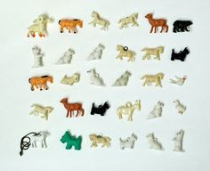 Tiny vintage plastic charms and figurines