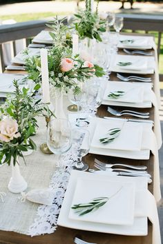 Romantic tablescape with vintage milk glass vases containing blush Garden Roses and rustic greenery. #wedding #flowers