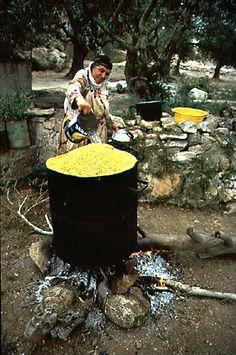 Arab woman cooking chickpeas at West Bank, occupied Jordan (Isreal)