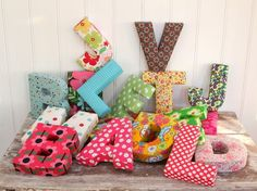 Fabric covered alphabet letters.