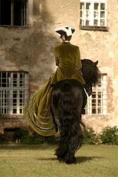 Breathtakingly beautiful ~ riding side saddle on a Friesian horse.