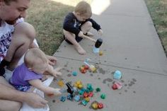 Ice Play. Freezing colored water in regular ice cube trays and freezing small toys in cups of colored water. Playing outside with ice and hammers.