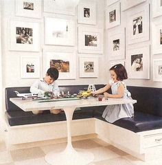 brainstorming for our idea of bench seating in the kitchen - love the framed family pics, but also love the area for your heels to kick back, in addition to the drawers at the ends... That's a smart option to have in addition to or instead of a hinged top,... !