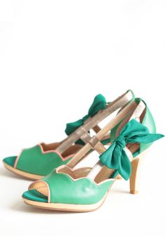 """Lucky Lady Heels By Poetic Licence 98.99 at shopruche.com. Bring out your whimsical side with these playful green leather heels by Poetic License adorned with a delicate bow tied just so. Finished with a shimmering gold colored heel and platform, pink scalloped details, and rosy pewter accents. Adjustable ankle strap.Leather upper, Lining man-made, Slightly padded footbed, 3.5"""" heel, 0.25"""" platform"""