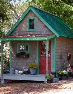 potting shed-A blend of old & new~ salvaged metal panels cover the porch roof .