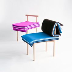"""Inspired by books, the Pages chair allows the user to adjust the seat height and backrest cushioning simply by turning its colorful padded """"pages."""" The imaginative design encourages interaction with the user and has a unique, fun and colorful aesthetic that is sure to be a conversation starter!"""