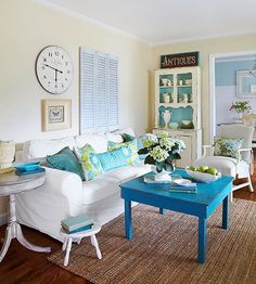 Update your old furniture by painting it a fun color, like this blue table! More cottage finds here: http://www.bhg.com/decorating/decorating-style/cottage/blue-cottage/?socsrc=bhgpin062314livingblue&page=2
