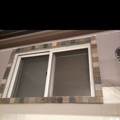 DIY window tile border. Used the left over tiles from my mirror project and framed over an ugly window frame in my shower...