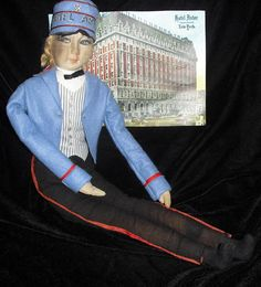Boudoir Doll dressed as bellboy from the Astor Hotel in New York.