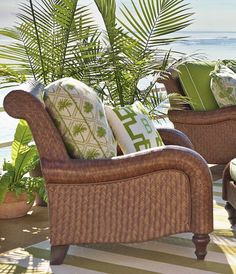 Sink into plush cushions comfortably fitted between the serpentine arms of estate-scaled, all-weather rattan with the Seychelles Seating Collection. | Frontgate: Live Beautifully