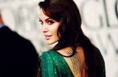 Angelina Jolie, emerald glitter dress.